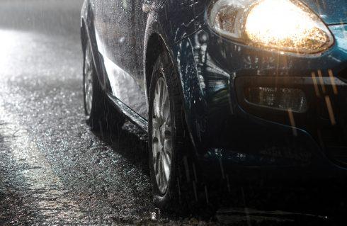 car in rain at night